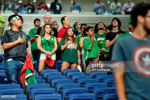 Fans of Mexico and other teams listen to the US national anthem before the Jamaica vs El Salvator CONCACAF Gold Cup match at the Alamodome July 16...