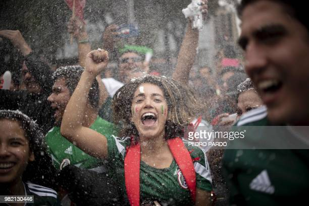 TOPSHOT Fans of Mexico celebrate at Angel de la Independencia monument in Mexico City after Mexico beat South Korea 21 in their World Cup group match...
