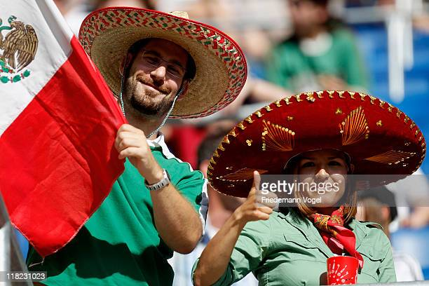 Fans of Mexico celebrates during the FIFA Women's World Cup 2011 Group B match between New Zealand and Mexico at RheinNeckar Arena on July 5 2011 in...