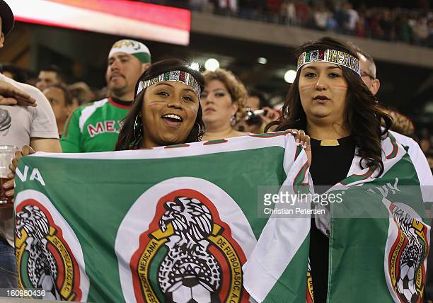 Fans of Mexico cheer during an international friendly match against Denmark at University of Phoenix Stadium on January 30 2013 in Glendale Arizona...