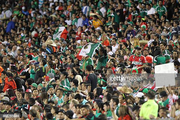 Fans of Mexico cheer for their team during an international friendly match between Paraguay and Mexico at Arrowhead Stadium on March 31 2015 in...