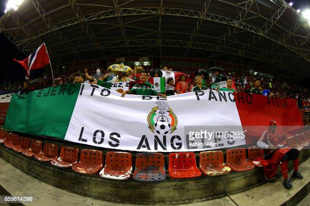 Fans of Mexico cheer for their team during the fifth round match between Trinidad Tobago and Mexico as part of the FIFA 2018 World Cup Qualifiers at...