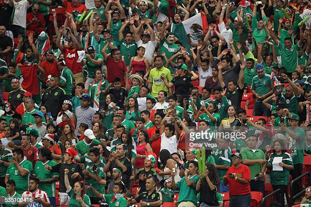 Fans of Mexico cheer for their team during the International Friendly between Mexico and Paraguay at Georgia Dome on May 28 2016 in Atlanta Georgia