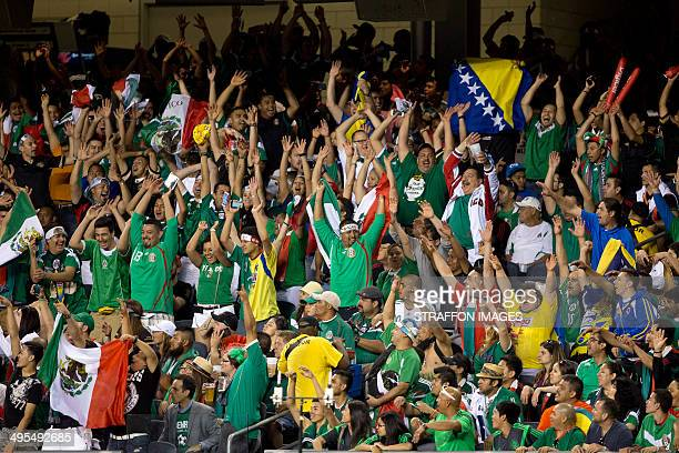 Fans of Mexico cheer their team during the Internatinal friendly match between Mexico and BosniaHerzegovina at Soldier Field on June 03 2014 in...