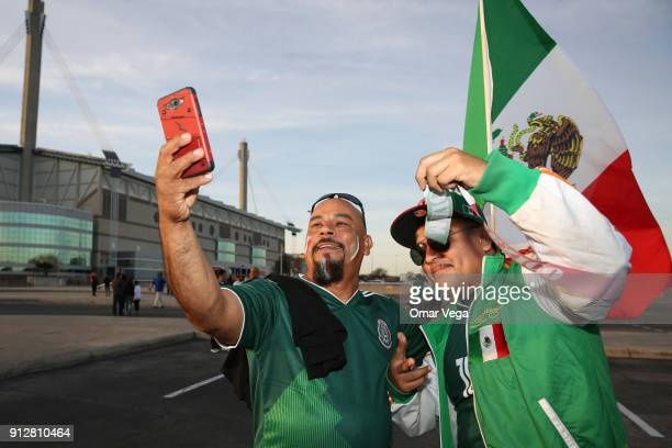 Fans of Mexico pose for a selfie prior the friendly match between Mexico and Bosnia and Herzegovina at Alamodome Stadium on January 31 2017 in San...