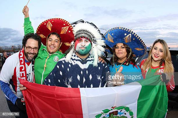 Fans of Mexico pose for photos outside the satadium prior the match between USA and Mexico as part of FIFA 2018 World Cup Qualifiers at MAPFRE...