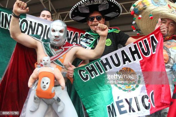 Fans of Mexico pose for photos prior the fifth round match between Trinidad Tobago and Mexico as part of the FIFA 2018 World Cup Qualifiers at Hasely...