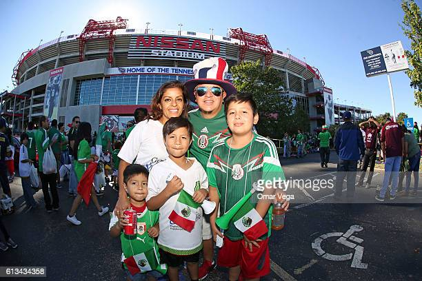 Fans of Mexico pose foro photos prior the International Friendly Match between Mexico and New Zealand at Nissan Stadium on October 08 2016 in...