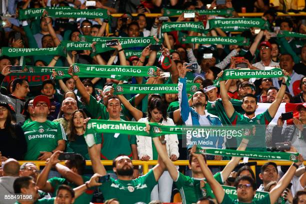Fans of Mexico show scrafs with the legend 2Fuerza Mexico' prior the match between Mexico and Trinidad Tobago as part of the FIFA 2018 World Cup...