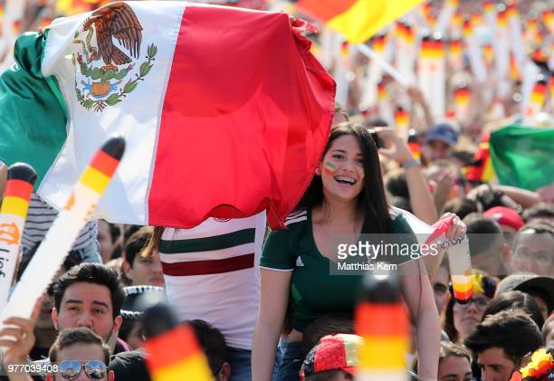 Fans of Mexico watch the 2018 FIFA World Cup match between Germany and Mexico at the Fanmeile public viewing at Brandenburg Gate on June 17 2018 in...