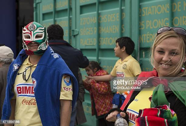 Fans of Mexico's Club America wait outside the Olympic Stadium before the CONCACAF Champions League return leg final against the Montreal Impact in...