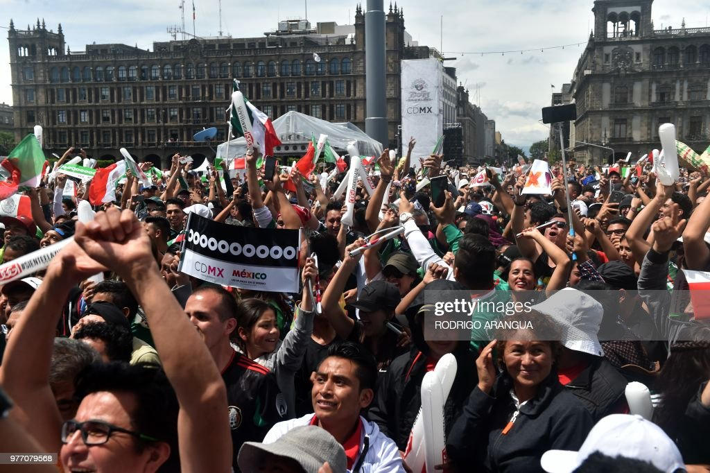 Fans of Mexico's football team celebrate during a public event at the Zocalo Square in Mexico City, on June 17 2018, during the start of the Russia 2018 World Cup Group F football match between Germany and Mexico.
