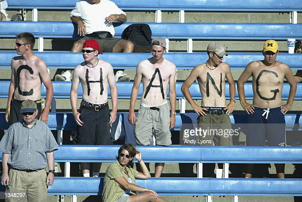 Fans of Michael Chang stand in the bleacher seats to spell out Chang on their bare chests for the match against Fernando Vicente during the Western...