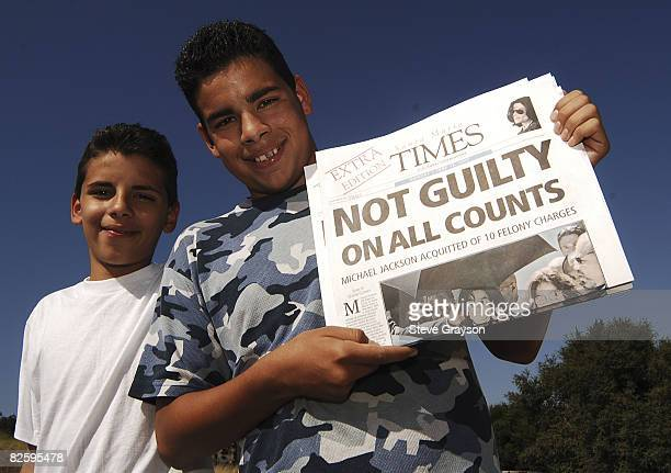 """Fans of Michael Jackson hold a special addition of the Santa Maria Times with the headline """"Not Guilty"""" outside the gates Michael Jackson's Neverland..."""