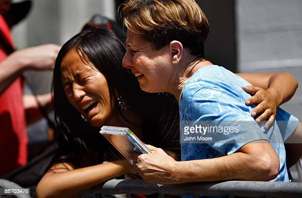 Fans of Michael Jackson Niki Yan and Lois Weiss weep while passing Jackson's star on the Walk of Fame on June 26 a day after his death in Los Angeles...