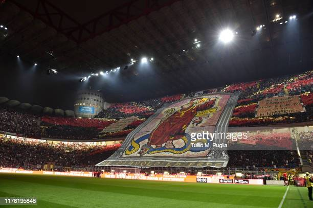 Fans of Milan show their support during the Serie A match between AC Milan and FC Internazionale at Stadio Giuseppe Meazza on September 21 2019 in...