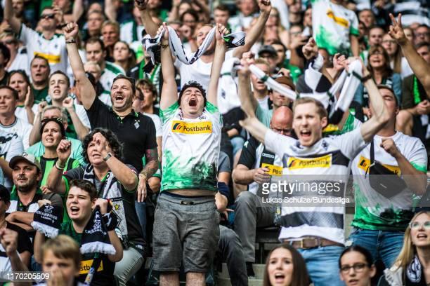 Fans of Mönchengladbach celebrate the win after the Bundesliga match between Borussia Mönchengladbach and Fortuna Düsseldorf at Borussia-Park on...