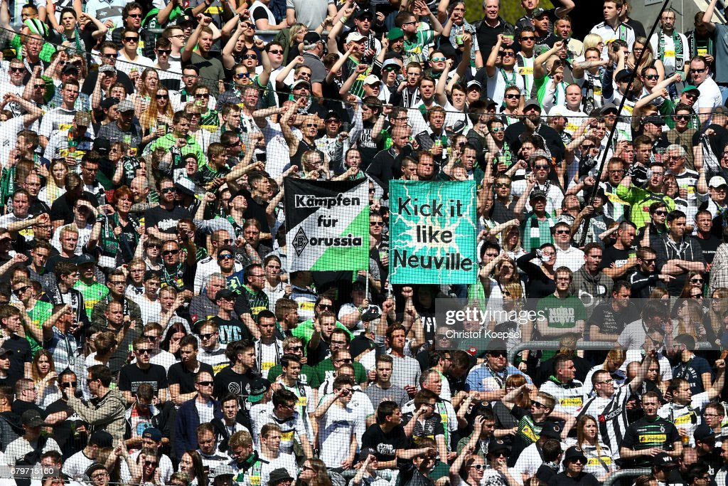 Fans of Moenchengladbach celebrate during the Bundesliga match between Borussia Moenchengladbach and FC Augsburg at Borussia-Park on May 6, 2017 in Moenchengladbach, Germany.