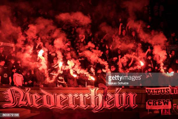 Fans of Moenchengladbach with pyrotechnics during the DFB Cup match between Fortuna Duesseldorf and Borussia Moenchengladbach at EspritArena on...