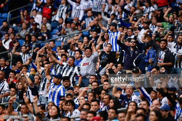 Fans of Monterrey cheer for their team during the 9th round match between Monterrey and Atletico San Luis as part of the Torneo Clausura 2020 Liga MX...