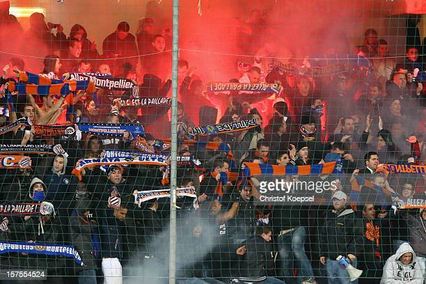 Fans of Montpellier hold up their scarves during the UEFA Champions League group B match between Montpellier Herault SC and FC Schalke 04 at Stade de...