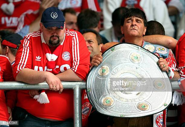 Fans of Muenchen are looking dejected after the Bundesliga match between 1899 Hoffenheim and FC Bayern Muenchen at the RheinNeckarArena on May 16...