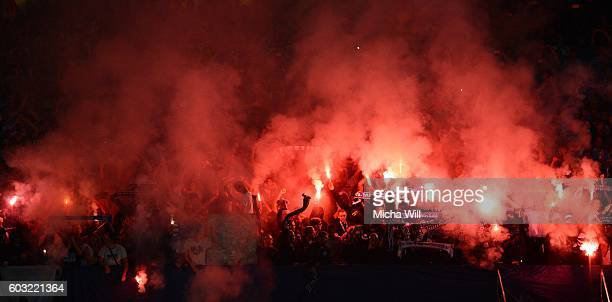 Fans of Muenchen burn flares during the Second Bundesliga match between 1 FC Nuernberg and TSV 1860 Muenchen at Arena Nuernberg on September 12 2016...
