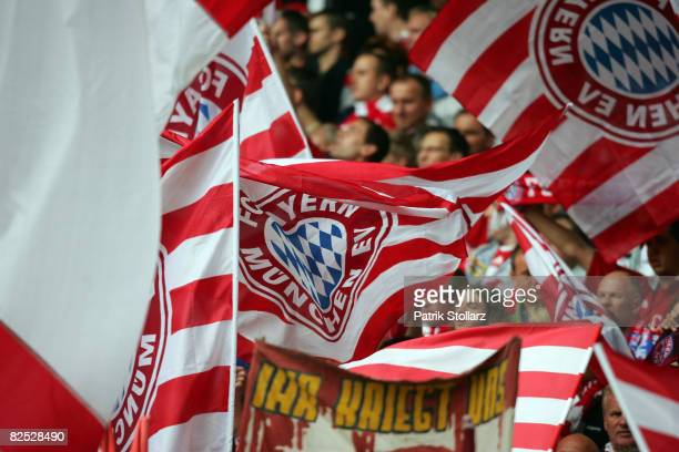 Fans of Muenchen cheer during the Bundesliga match between Borussia Dortmund and FC Bayern Muenchen at the SignalIduna Park on August 23 2008 in...