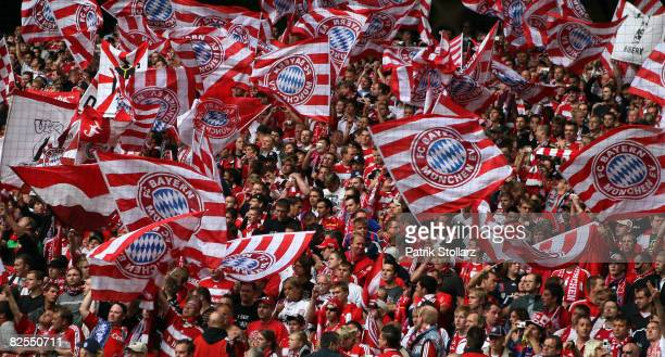 Fans of Muenchen cheer during the Bundesliga match between Borussia Dortmund and FC Bayern Muenchen at the Signal-Iduna Park on August 23, 2008 in...