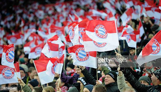 Fans of Muenchen wave flags before the Bundesliga match between FC Bayern Muenchen and Borussia Dortmund at Allianz Arena on December 1 2012 in...