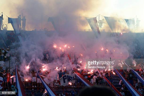 Fans of Nacional celebrate after their team winning the title during a match between Nacional and Boston River as part of Campeonato Uruguayo 2016 at...