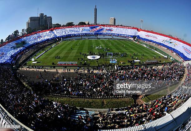 Fans of Nacional display a flag before a match between Nacional and Atletico Madrid as part of the Copa Euroamericana at the Centenary Stadium on...