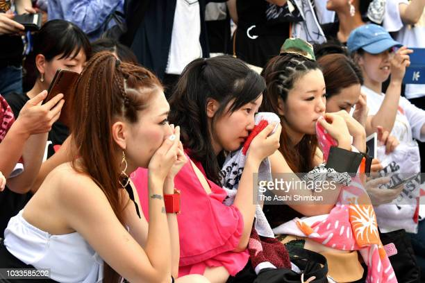 Fans of Namie Amuro shed tears prior to her performance in front of the Okinawa Convention Center on September 15 2018 in Ginowan Okinawa Japan