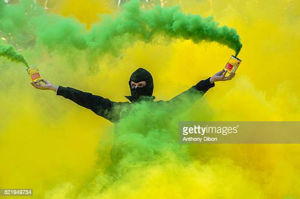Fans of Nantes with Smoke Bombs during the French Ligue 1 between Nantes and Montpellier at Stade de la Beaujoire on April 17 2016 in Nantes France