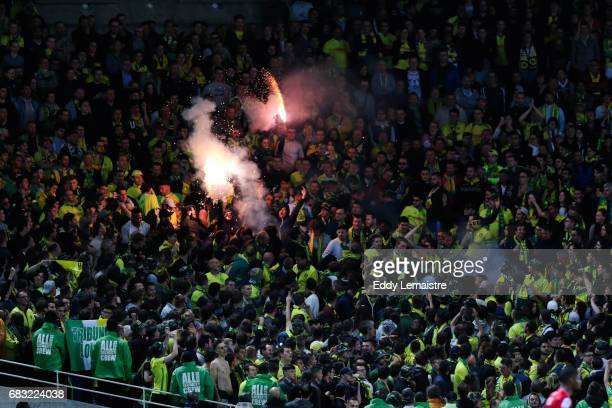 Fans of Nantes with smoke bombs during the Ligue 1 match between FC Nantes and EA Guingamp at Stade de la Beaujoire on May 14 2017 in Nantes France
