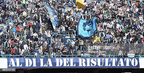 Fans of Napoli during the Serie A match between SSC Napoli and Empoli FC at Stadio San Paolo on December 7 2014 in Naples Italy