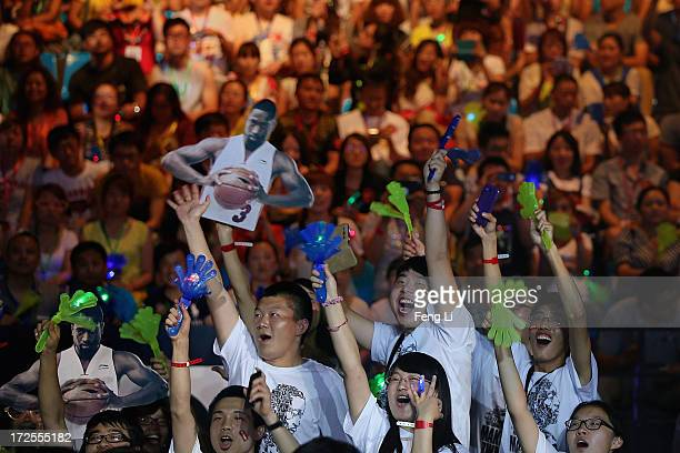 Fans of NBA Player Dwyane Wade attend a promotion event of Chinese sports brand Li Ning on July 3 2013 in Beijing China