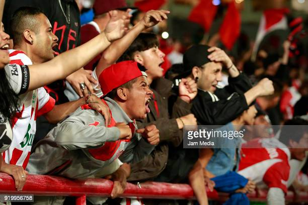 Fans of Necaxa cheer for their team during the 8th round match between Necaxa and Monterrey as part of the Torneo Clausura 2018 Liga MX at Victoria...