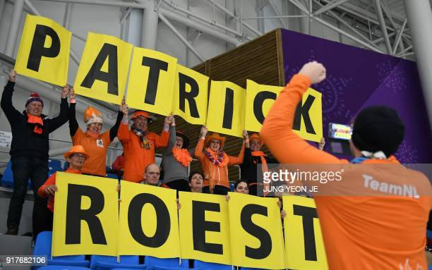 TOPSHOT Fans of Netherlands' Patrick Roest show their support prior to the men's 1500m speed skating event during the Pyeongchang 2018 Winter Olympic...
