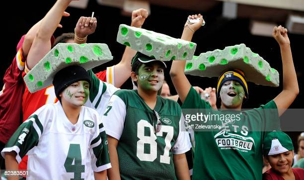 Fans of new Jets quarterback Brett Favre cheer during an NFL game between the New York Jets and the Washington Redskins at Giants Stadium August 16...