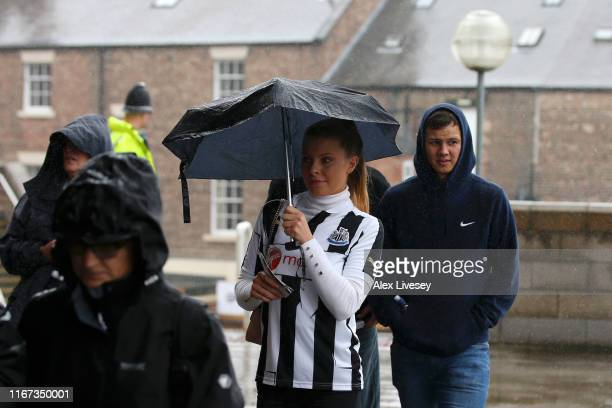Fans of Newcastle make their way to the stadium prior to the Premier League match between Newcastle United and Arsenal FC at St. James Park on August...