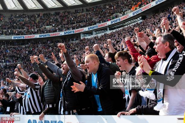 Fans of Newcastle United celebrate at full time during the Premier League match between Newcastle United and Arsenal at St James Park on April 15...