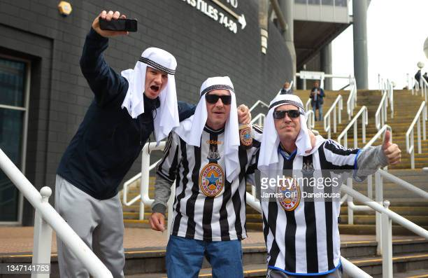 Fans of Newcastle United dressed in Fancy Dress are seen prior to the Premier League match between Newcastle United and Tottenham Hotspur at St....