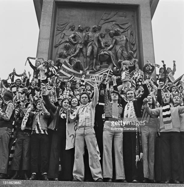Fans of Newcastle United FC in London for the 1974 FA Cup Final against Liverpool at Wembley Stadium, UK, 4th May 1974. They are standing at the base...