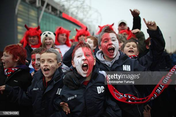 Fans of non league side Crawley Town enjoy the atmosphere outside Old Trafford as their team prepare to take on Manchester United in the FA Cup fifth...