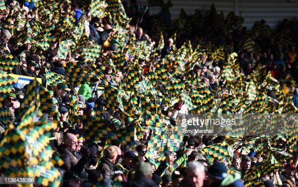 Fans of Northampton Saints wave their flags before the Premiership Rugby Cup Final match between Northampton Saints and Saracens at Franklin's...