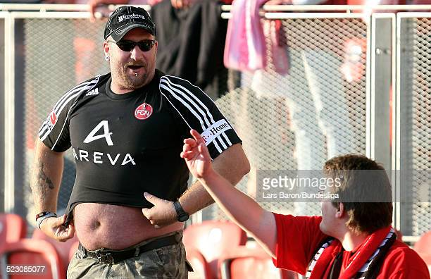 Fans of Nuernberg celebrate during the Bundesliga Play Off match between FC Energie Cottbus and 1.FC Nuernberg at the Stadion der Freundschaft on May...