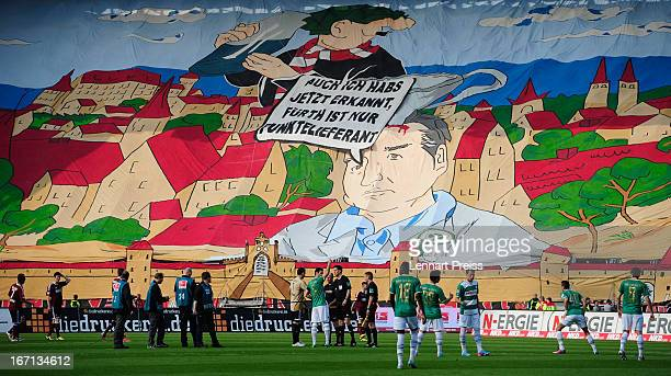 Fans of Nuernberg display a banner before the Bundesliga match between 1. FC Nuernberg and SpVgg Greuther Fuerth at Stadium Nuremberg on April 21,...