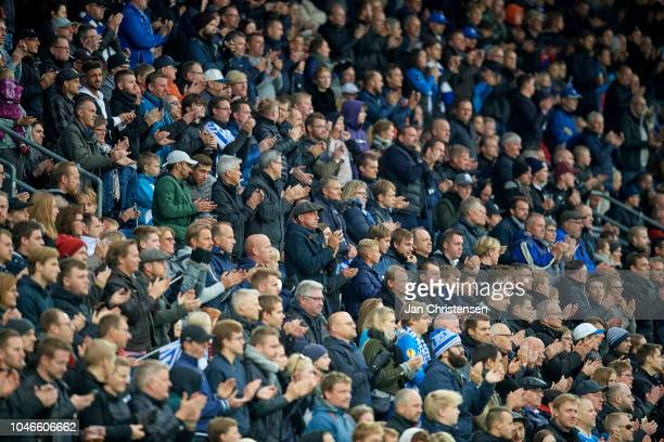 Fans of OB celebrate the deceased singer Kim Larsen during the Danish Superliga match between OB Odense and AGF Arhus at Nature Energy Park on...