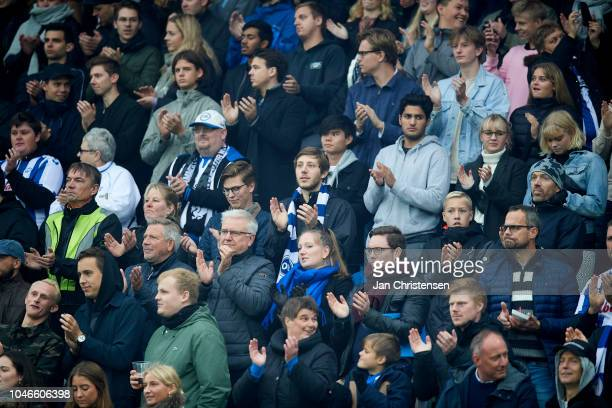 Fans of OB celebrate the deceased singer Kim Larsen prior to the Danish Superliga match between OB Odense and AGF Arhus at Nature Energy Park on...